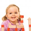 Happy girl with wooden blocks — Stock Photo #6409559