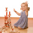 Happy little girl with wooden blocks — Stock Photo #6409560