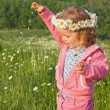 Little girl playing with flower petals — Stock Photo #6409563