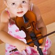 Little girl with a violin - top view — Stock Photo #6409568