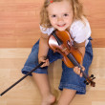 Little musician girl — Stock Photo #6409570