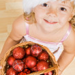 Little girl with christmas balls — Stock Photo