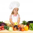 Happy little chef with vegetables — Stock Photo