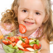 Happy little girl with a large bowl of fruit salad — Stock Photo #6409704