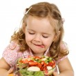 Little girl about to taste the fruit salad — Stock Photo