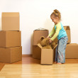 Excited little girl unpacking in her new home — Stock Photo #6409754