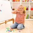 Happy little girl learning the numbers — Stock Photo #6409757