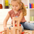 Child playing with blocks on the floor — Stock Photo