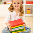 Happy little girl with books — Stock Photo