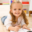 Little girl learning to read - Stock Photo