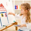 Stock Photo: Little artist girl with her masterpiece