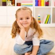 Happy little girl sitting in her room at home — Stock Photo #6409781