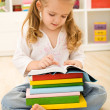 Little girl with lots of books — Stock Photo