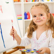 Happy little artist - girl painting a house — Stock Photo #6409797