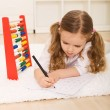 Little girl doing simple math exercises — Stok fotoğraf