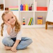 Happy little girl in her room sitting — Stock Photo #6409813