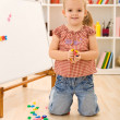 Little girl playing with magnetic board — Stock Photo #6409817