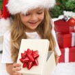 Little girl opening christmas present — Foto Stock