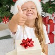 Extremely happy litte girl with christmas present — Stock Photo