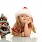 menina com pequena árvore de Natal — Foto Stock