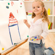 Foto Stock: Little artist girl painting her dream house