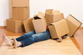 Man covered in cardboard boxes - moving concept — Stock Photo