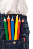 Colored pencils in kids jeans pocket — Stock Photo
