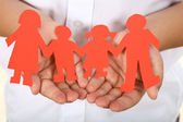 Paper holding hands - family concept — Stock Photo