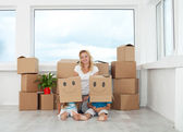 Woman with playing kids in their new home — Stock Photo