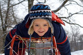 Little boy on a sledge — Stock Photo