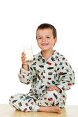 Happy healthy little boy with a glass of milk — Stock Photo