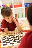 Serious chess player kid — Stock Photo