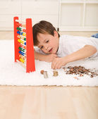 Little boy counting his savings — Stock Photo