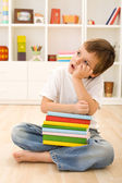 Bored kid with lots of school books — Stock Photo