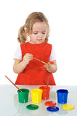 Serious girl with painting kit — Stock Photo