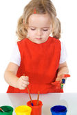 Little painter girl absorbed by the work — Stockfoto