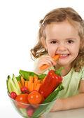 Happy carrot chomping girl — Stock Photo