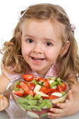 Happy little girl with a bowl of fruit salad — Stock Photo