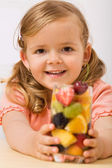 Happy girl with fruit salad or drink — Stock Photo