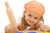 Happy girl with a rolling pin — Stock Photo