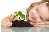 Little girl happy about her plant — Стоковое фото