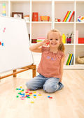 Happy little girl learning the numbers — Stock Photo