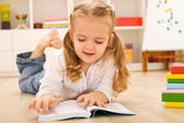One day I will read all this - little girl with books — Stock Photo