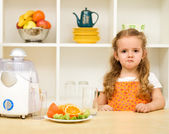 Little girl making faces - fruit juice again ? — Stock Photo