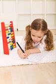 Little girl doing simple math exercises — Stock Photo