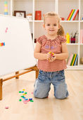 Little girl playing with magnetic board — Stock Photo