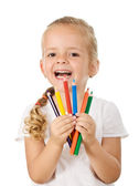Happy little girl with colored pencils — Stock Photo