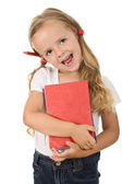 Happy little girl with books and pencil behind the ear — Stock Photo