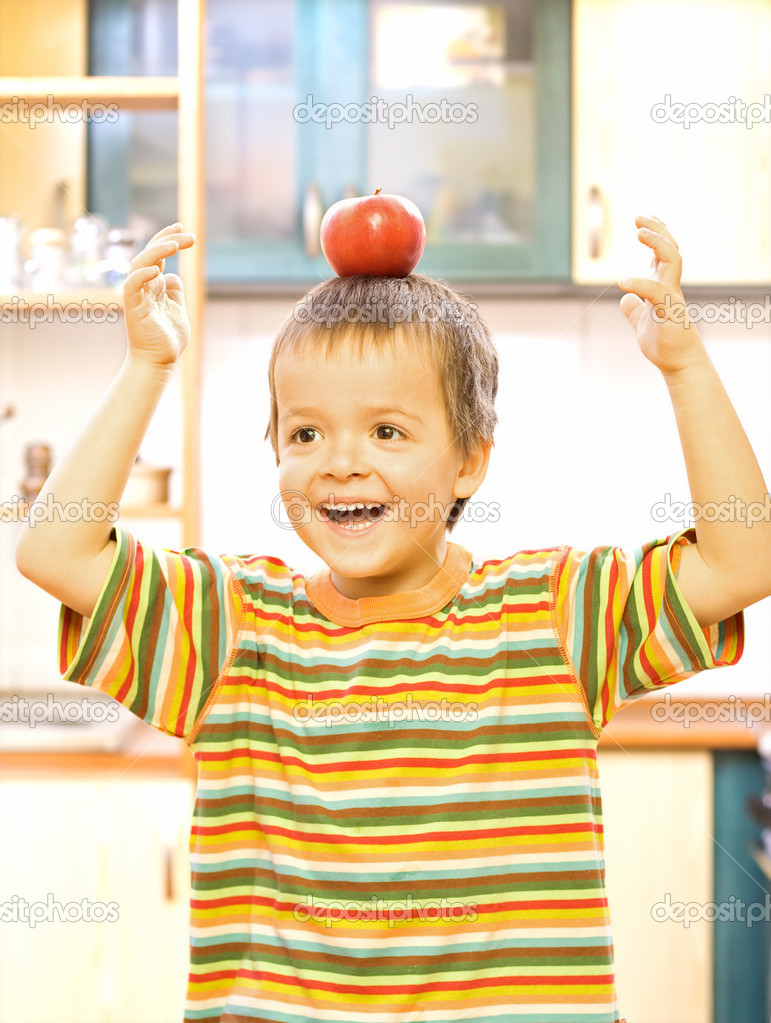 Happy boy with apple - balanced diet concept  Stock Photo #6409200