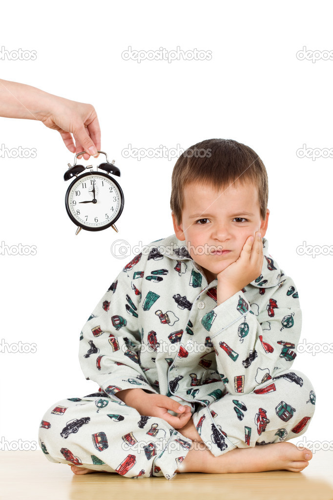 Bedtime for a displeased kid in pajamas - isolated — Stock Photo #6409295